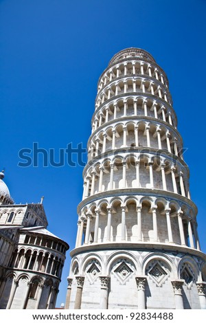 Italy - Pisa. The famous leaning tower on a perfect blue bakcground