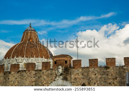 Italy. Pisa. The roof of the Baptistery in the Square of Miracles behind a fence around the complex