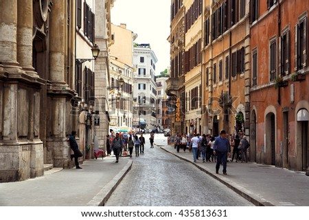 ITALY. ROME - APRIL 19, 2016: Tourists walk on the ancient streets on a background of ancient architecture.