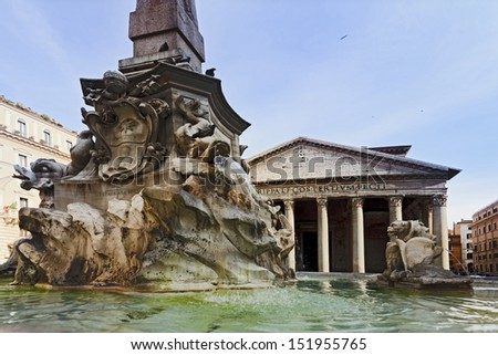 Italy rome capital city of ancient civilisation modern square pantheon portico with columns and fountain flowing water down from obelisk day time - stock photo