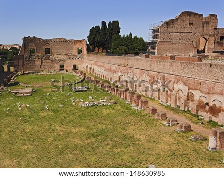 italy rome capital of ancient roman empire ruins of forum classical buildings of bricks and stones circus of Maximus - stock photo