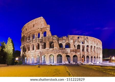 Italy Rome coliseum ruins at sunrise illuminated lights stone made ancient roman landmark  - stock photo