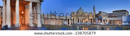 Italy Rome vatican main square of St Peter with Cathedral and colonnade wings behind fence at sunrise with lights illumination - stock photo
