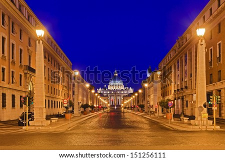 Italy ROme Vatican st peter cathedral at the end of the road city street illuminated with streetlights at sunrise houses and buildings - stock photo