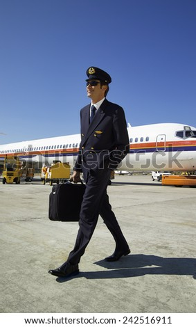 Italy, Sardinia, Olbia International Airport, male flight assistant unboarding - stock photo