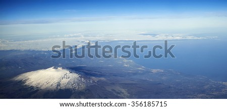Italy, Sicily, aerial view of the sicilian eastern coastline and volcano Etna