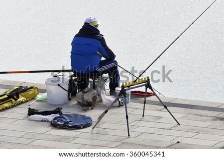 Italy, Sicily, Marina di Ragusa; 9 January 2016, fisherman in the port - EDITORIAL - stock photo