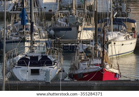 Italy, Sicily, Mediterranean sea, Marina di Ragusa; 26 December 2015, view of luxury yachts in the marina at sunset - EDITORIAL - stock photo