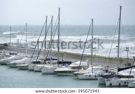 Italy, Sicily, Mediterranean sea, Marina di Ragusa; 23 March 2016, luxury yachts in the marina during a storm - EDITORIAL - stock photo