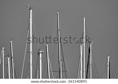 Italy, Sicily, Mediterranean sea, Marina di Ragusa, sailing boat  masts in the marina - stock photo
