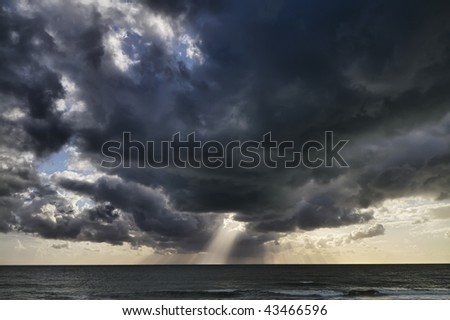 Italy, Sicily, mediterranean sea, southern coast, dark clouds in the sky