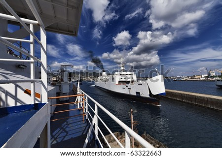 Italy, Sicily, Messina, view of the city and the port from one of the ferryboats that connect Sicily to the Italy peninsula crossing the sicily channel - stock photo