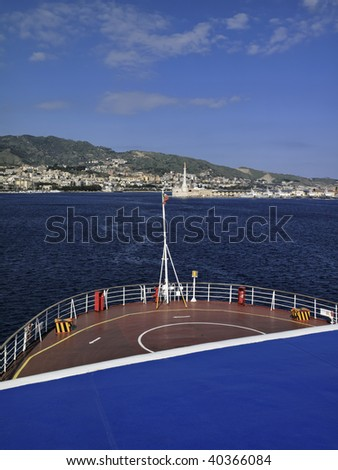 Italy, Sicily, Messina, view of the city and the port from the ferryboat that connects Sicily to the Italy peninsula crossing the sicily channel - stock photo
