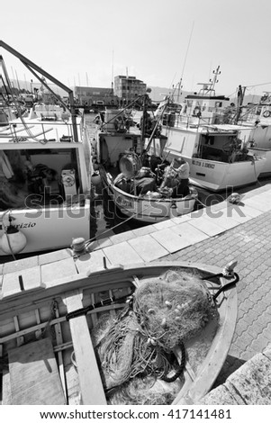 Italy, Sicily, Porto Rosa (Messina Province);  27 March 2011, fishermen working on their fishing boats - EDITORIAL
