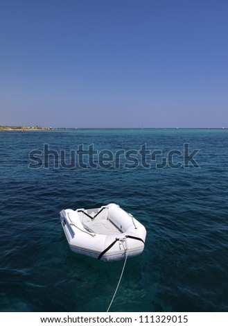 Italy, Sicily, Portopalo di Capo Passero (Siracusa Province), view of a tender and the clear waters of the island