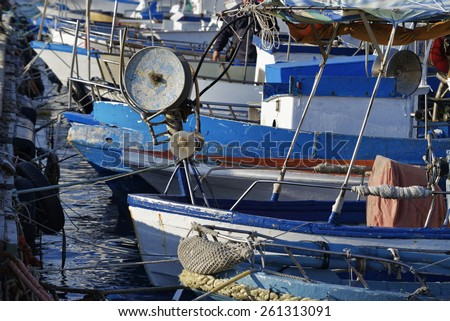 Italy, Sicily, Portopalo di Capo Passero, wooden fishing boats in the port - stock photo