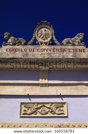 Italy, Sicily, Ragusa Ibla, decorations in a baroque palace facade