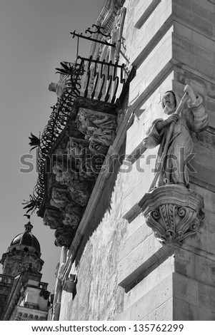 Italy, Sicily, Ragusa Ibla, the baroque facade of Cosentini Palace (Unesco monument), ornamental statue