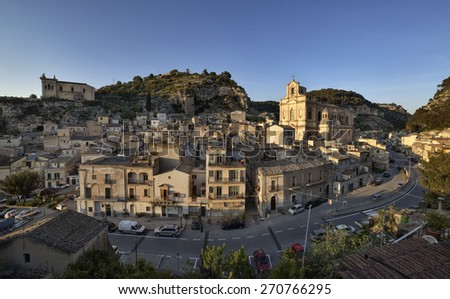 Italy, Sicily, Scicli (Ragusa Province), panoramic view of the town and S. Maria La Nova Neoclassic Church (1816 a.C.) - stock photo