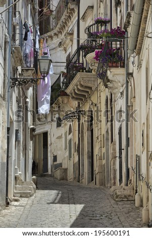 Italy, Sicily, Scicli (Ragusa Province), view of an old street in the town
