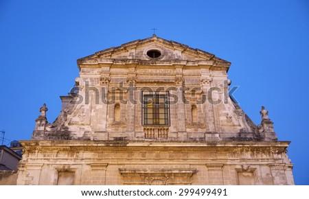 Italy, Sicily, Scicli (Ragusa Province), view of S. Maria La Nova Neoclassic Church facade (1816 a.C.) at sunset - stock photo