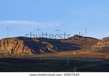 ITALY, Sicily, Sicani mounts, Eolic energy turbines and high voltage cables - stock photo