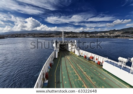 Italy, Sicily, Sicily channel, view of the sicilian coastline and Messina from the ferryboat that connects Sicily to the Italy peninsula - stock photo