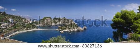 Italy, Sicily, Taormina bay, panoramic view of Capo Taormina and Isola Bella, Calabria coastline in the far background - stock photo