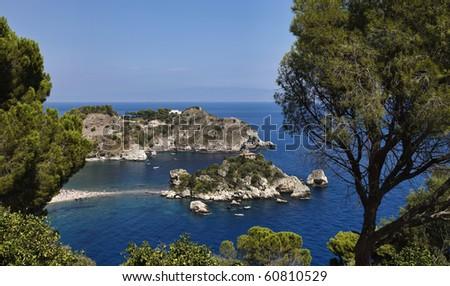 Italy, Sicily, Taormina bay, view of Capo Taormina and Isola Bella, Calabria coastline in the far background - stock photo