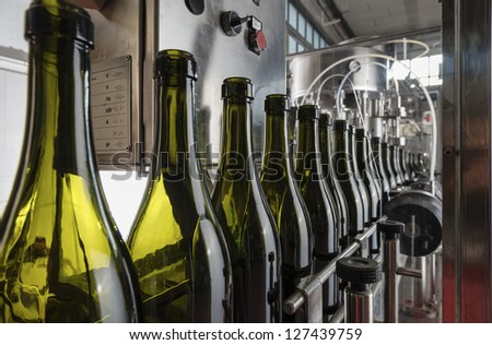 Italy, Sicily, wine bottles ready to be washed and filled with wine by an industrial machine in a wine factory