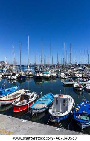Italy, small and colorful boats in the Sanremo marina harbor.