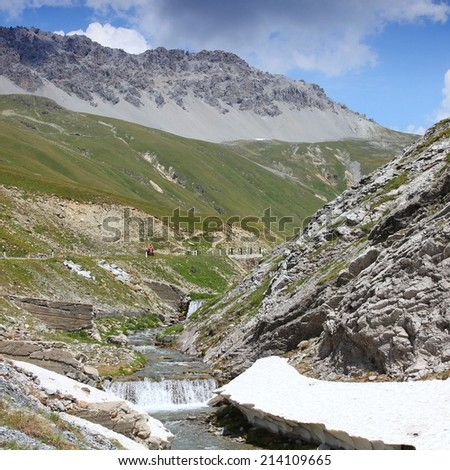Italy, Stelvio National Park. Famous road to Stelvio Pass in Ortler Alps. Alpine landscape. Square composition. - stock photo