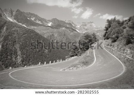 Italy, Stelvio National Park. Road to Gavia Pass in Ortler Alps. Black and white tone. - stock photo