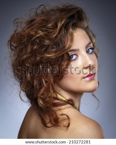Italy, studio portrait of a beautiful girl