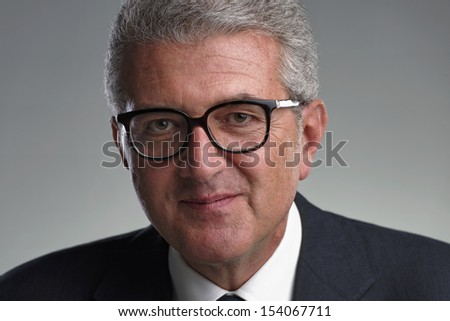 Italy, studio portrait of a middle age business man - stock photo