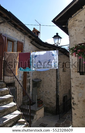 Italy, tiny street in a village, laundry outside