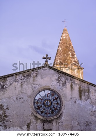 italy, tuscany, Capalbio (Grosseto), cathedral's facade and bell tower - stock photo