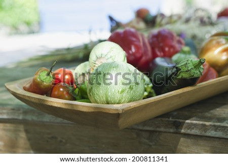 Italy, Tuscany, Magliano, Close up of various vegetables in wood tray - stock photo
