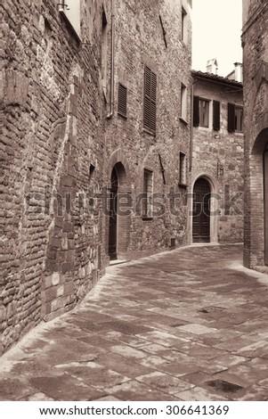 Italy. Tuscany region. Montepulciano town. Medieval street. In Sepia toned. Retro style - stock photo