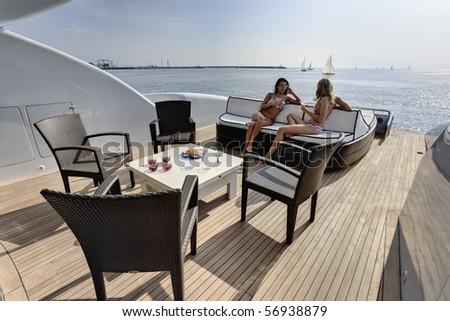 Italy, Tuscany, Viareggio, Tecnomar Velvet 90' luxury yacht, backboard deck - stock photo