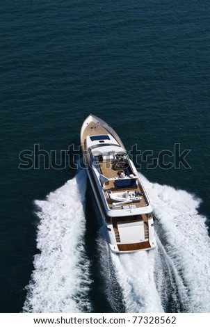 Italy, Tyrrhenian Sea, off the coast of Viareggio, Tecnomar 35 Fly luxury yacht, aerial view - stock photo