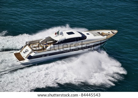 Italy, Tyrrhenian Sea, off the coast of Viareggio (Tuscany), Tecnomar 26 luxury yacht, aerial view - stock photo