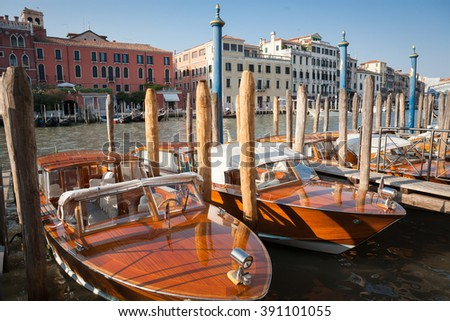 Italy, Venice beautiful city landscape sunny day. Ancient old city on the water with blue sky, bridges and green canals - stock photo