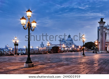 Italy Venice sunrise view on st marco square and Sana Maria Della Salute cathedral with lighting street lamps - stock photo