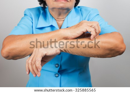 Itching In A old woman - stock photo