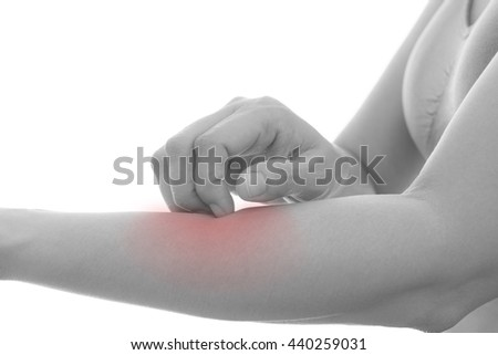 Itching of skin diseases in women using the hand-scratching. Red around the Itching area. Concept with Healthcare And Medicine. - stock photo