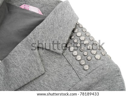 Item gray knitted jacket. Shoulder straps with metal rivets - stock photo