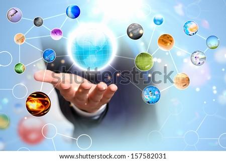 Items and icons on human hand. Global technologies - stock photo