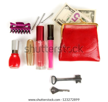 Items contained in the women's handbag isolated on white - stock photo