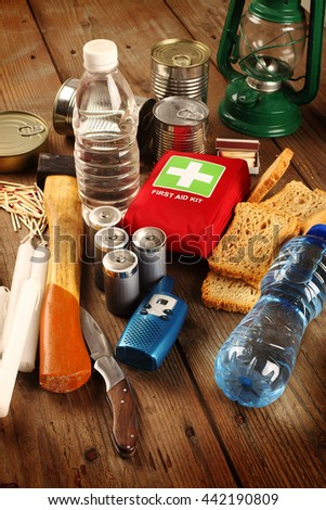 Items for emergency on wooden table - stock photo